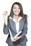 亚洲女实业家美好的年轻俏丽的姿态微笑的drawi 库存照片