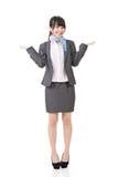 年轻亚洲女实业家耸肩 免版税库存照片