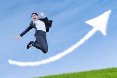 亚洲女实业家跳跃赢取 免版税库存照片