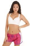 亚洲妇女健身粉红色短缺严重 库存照片