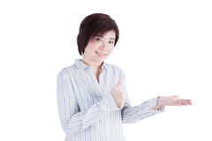 亚洲妇女显示优秀在她的手 免版税图库摄影