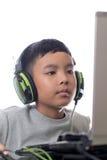 亚洲孩子戏剧计算机游戏(被射击的特写镜头) 免版税库存图片