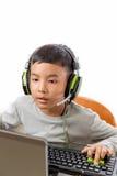 亚洲孩子戏剧计算机游戏 免版税库存图片