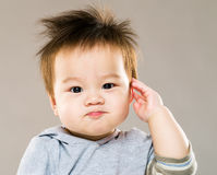 亚洲婴孩致敬 免版税库存图片