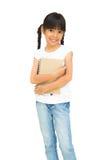 亚洲小女孩藏品笔记本 免版税库存照片