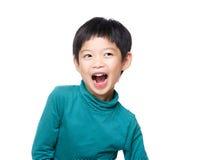 亚洲小男孩激动 免版税库存图片