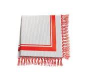 与红色和白色装饰的亚麻布餐巾。 桌布 免版税库存照片