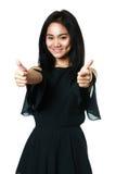 亚洲显示的赞许妇女年轻人 免版税库存照片