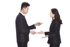 亚洲有商人和的女实业家论据 免版税库存图片