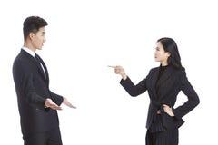 亚洲有商人和的女实业家论据 免版税库存照片