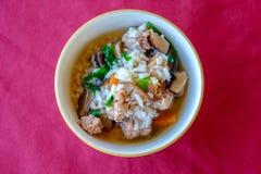 亚洲样式食物吃用半熟米 免版税图库摄影
