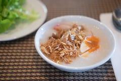 亚洲样式食物吃用半熟米 库存图片