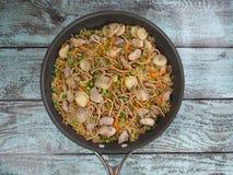 亚洲猪肉长柄浅锅 库存图片