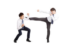 亚洲生意人战斗 免版税库存照片