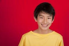 亚洲男孩微笑少年 免版税库存照片