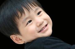 亚洲男孩微笑 免版税库存图片