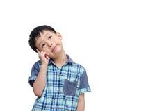 年轻亚洲男孩认为 库存照片