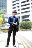 年轻亚洲男性商业主管微笑的画象 图库摄影