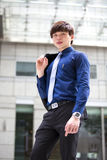 年轻亚洲男性商业主管微笑的画象 免版税图库摄影