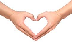 亚洲男性手做的心脏的形状被隔绝在白色 免版税库存图片