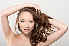 亚洲秀丽面孔和头发 免版税图库摄影