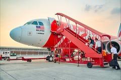 亚洲航空飞行在机场 免版税图库摄影