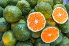 亚洲绿色桔子 免版税库存图片