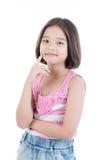亚洲逗人喜爱的女孩身分画象  免版税库存图片