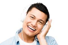 亚洲lsitening对音乐  免版税库存图片