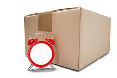 交付卡片盒和红色时钟没有拨号盘在被隔绝的白色背景与阴影 delive准时货物和的岗位的概念 库存照片