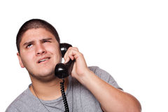 交谈令人沮丧的电话 免版税库存照片
