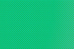 交错的栅格-绿松石和淡黄绿被仿造的导线 图库摄影