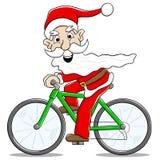 交付圣诞节礼物的自行车的圣诞老人 免版税库存照片