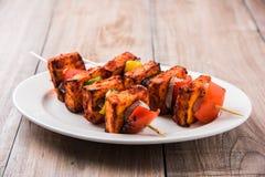 亦称烤酸奶干酪或Paneer蒂卡Kebab或辣椒paneer或者辣椒paneer或tandoori paneer在印度印度,酒吧 免版税图库摄影