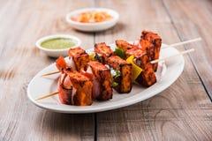 亦称烤酸奶干酪或Paneer蒂卡Kebab或辣椒paneer或者辣椒paneer或tandoori paneer在印度印度,酒吧 免版税库存照片