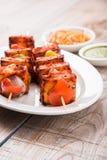 亦称烤酸奶干酪或Paneer蒂卡Kebab或辣椒paneer或者辣椒paneer或tandoori paneer在印度印度,酒吧 库存图片
