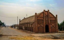 亦称Mudhif,沼泽的阿拉伯人传统房子madan,伊拉克 免版税库存照片