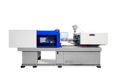 产品制造的机器从塑料挤压的 库存照片