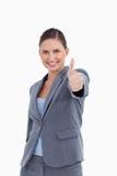 产生她审批的微笑的女推销员 库存图片
