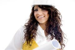 产生姿势微笑年轻人的行政女性 免版税库存图片