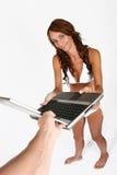 产生膝上型计算机妇女的去比基尼泳装 库存照片