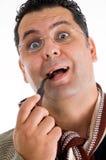 产生藏品人烟斗烟的惊奇表达式 免版税图库摄影