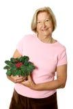 享受从事园艺她的前辈 免版税库存照片