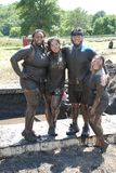 享受地方泥奔跑的朋友 图库摄影