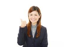 享受成功的女商人 库存图片