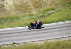 享受摩托车乘驾的车手 免版税库存照片