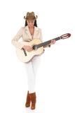 享受音乐的时髦的吉他演奏员 库存照片