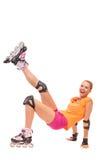 享受rollerblading的笑的少妇 免版税库存图片
