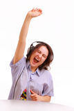 享用女孩耳机音乐年轻人 库存图片