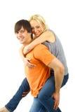 享用女性愉快的肩扛乘驾年轻人 库存图片